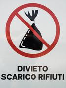 """Road sign with writing in Italian """"prohibition waste discharge"""". Stock Photos"""