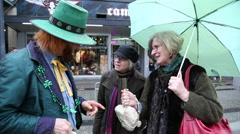 Leprechaun talking elderly females Stock Footage