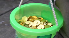 Wealthy leprechaun bucket full of coins Stock Footage