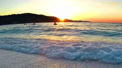 Sunset on the beach - Tranquil idyllic scene of a golden sunset over the sea, - stock footage