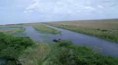 Aerial of Air Boat in the Florida Everglades - stock footage