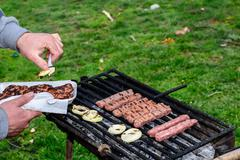 Barbecue in nature. Baking meatballs on charcoal. Stock Photos