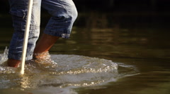 Man crosses the river Stock Footage