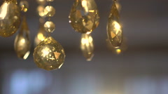 Luxury crystals of a classic chandelier on a dark background. Slow motion - stock footage