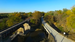 Aerial of Railroad Bridge with Fall Colors Stock Footage