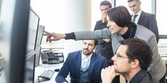 Business team working in corporate office. - stock photo