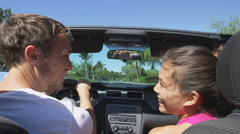 Car couple driving on road trip travel vacation - Man driver, woman passenger - stock footage