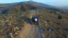 Aerial shot of a ATV driving on a rocky mountain trail - stock footage