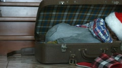Little Santa sleeping in suitcase. Stock Footage