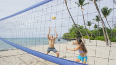 Young People playing Volleyball on the Beach - sport in  SLOW MOTION Stock Footage