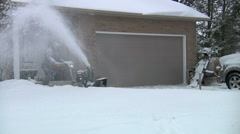 Man Using Snow Blower To Clear Driveway Stock Footage