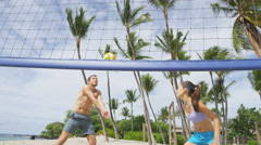 Friends playing beach volleyball sport in summer - people having beach fun Stock Footage