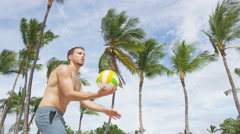 Beach volleyball serve - man serving in beach volley ball game Stock Footage