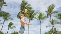 Beach volleyball serve - man spike serving in game Stock Footage
