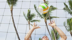 Beach volleyball sport in summer man setting ball - Friends playing outdoors Stock Footage