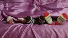 Small feet in colorful socks. Stock Footage