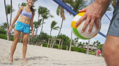 Beach volleyball Friends playing sport having fun - people in healthy lifestyle Stock Footage