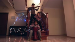 Three kids playing Christmas music. Stock Footage