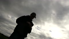 Young male using smartphone cloudy sky Stock Footage