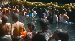 Unidentified worshipers bathing at Tirta Empul temple in Bali, Indonesia Stock Footage