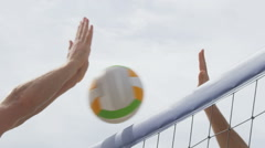 Beach volleyball net closeup spiking and blocking - male player spike and block - stock footage