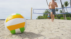 Friends playing beach volleyball sport having fun - people in healthy lifestyle - stock footage