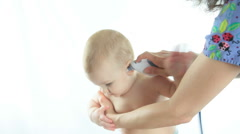 Isolated Little Baby Boy With Female Doctor - stock footage