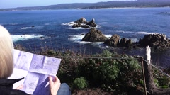 Point Lobos State Park, Woman studying tourist guide Stock Footage