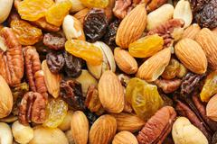 Assorted mix of dry fruits and Nuts almond,cashew, peanut,raisin and walnut - stock photo