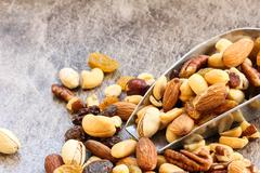 Assorted mix of dry fruits and Nuts almond,cashew, peanut,raisin and walnut w - stock photo