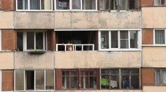 Worker install plastic window at recessed balcony, large apartment house Stock Footage