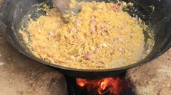 Cooking on a fire in the open air. So feed merchants at the fair. Bagan. Myanmar Stock Footage