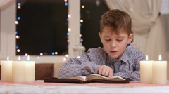 Kid reading book out loud. - stock footage
