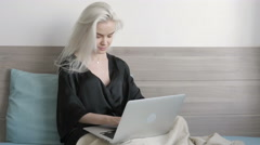 Attractive Beautiful Girl Chat with Friend on Laptop in bed at Morning - stock footage