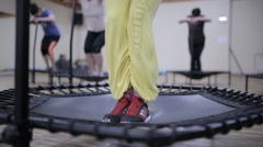 Fitness trainer show exercise with Trampoline Stock Footage