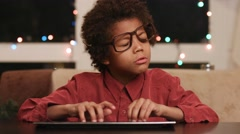 Frustrated kid sitting at keyboard. Stock Footage