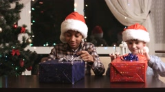 Two boys with Christmas presents. Stock Footage