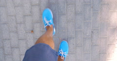 Man walking down the street in blue moccasins Stock Footage