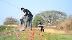 Thai people throw color paper and praying graveyard in Qingming Festival Stock Footage