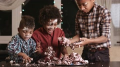 Afro kids greedily eating cake. Stock Footage