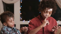 Two black boys destroying cake. Stock Footage