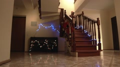 Christmas kids run down staircase. - stock footage