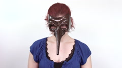 Portrait of a young red headed woman with a long nose masquerade mask on (1) - stock footage