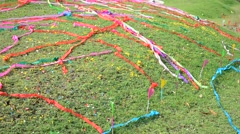 Wind and moving of colored paper on a grave Stock Footage
