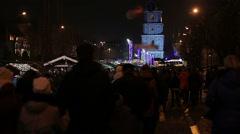 Stock Video Footage of Crowd of people walking down central street, enjoying Christmas festivities