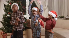 Darkskinned children using Christmas petard. - stock footage