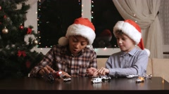 Boys with toys on Christmas. Stock Footage