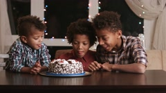 Hungry boys and birthday cake. Stock Footage