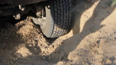 The wheels of the car skid to a halt in the sandy soil Stock Footage