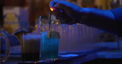 Barman making presentation of cocktails - stock footage